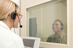 Audiologist and patient conducting hearing test - Omaha NE